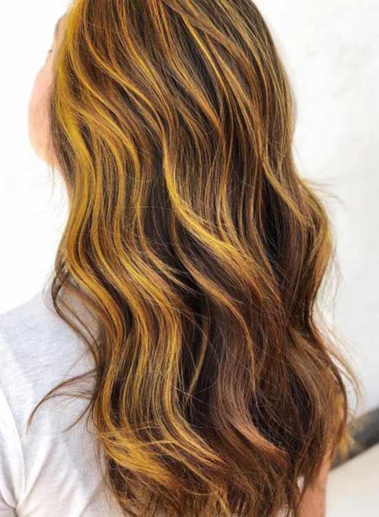 Yellow hair highlight dark brown brunette hair